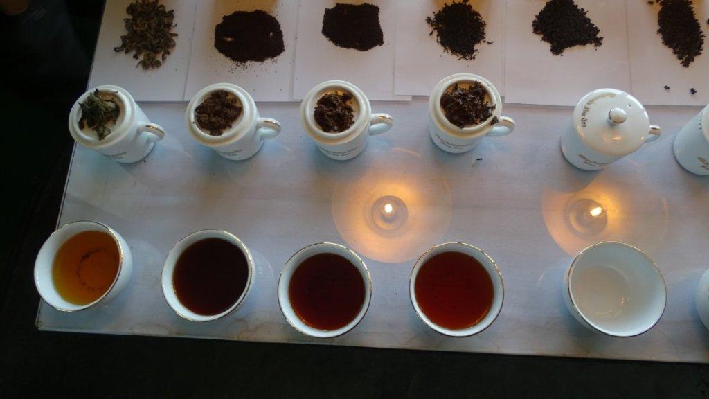 A selection of teas varying in colur, served in elegant china at Mackwood's Museum in Nuwara Eliya