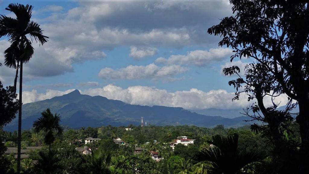 A characteristic shape of Adam's Peak seen from a village near Kandy