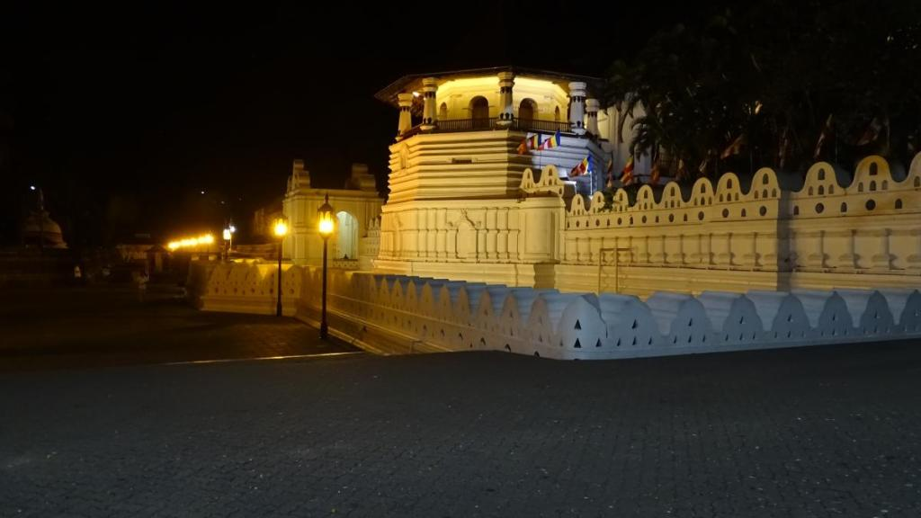 White, external walls of the Temple of the Sacred Tooth in Kandy illuminated at night