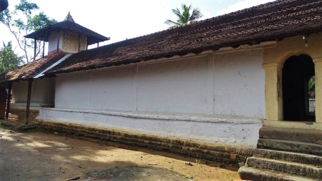 A long, one-storied, tile-roofed building of Embekke devale (shrine) near Kandy