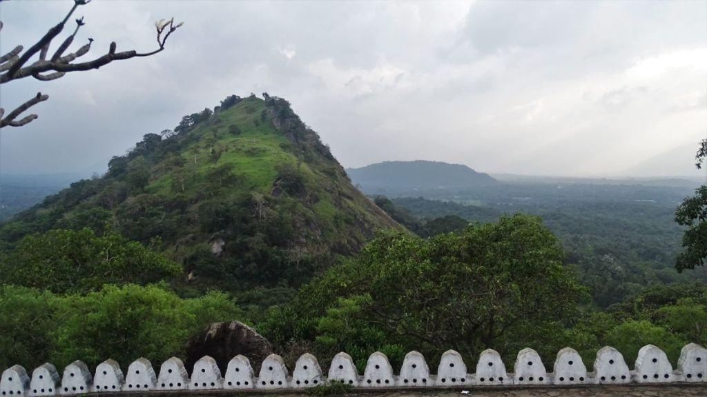 A view at the rocks and green plains from Dambulla Cave terrace