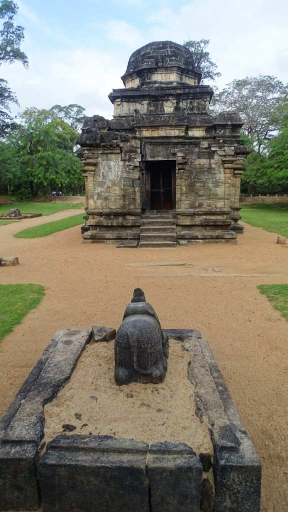 A complete, tiny stone temple of Siva with a small headless bull statue facing it at the Polonnaruwa ancient city