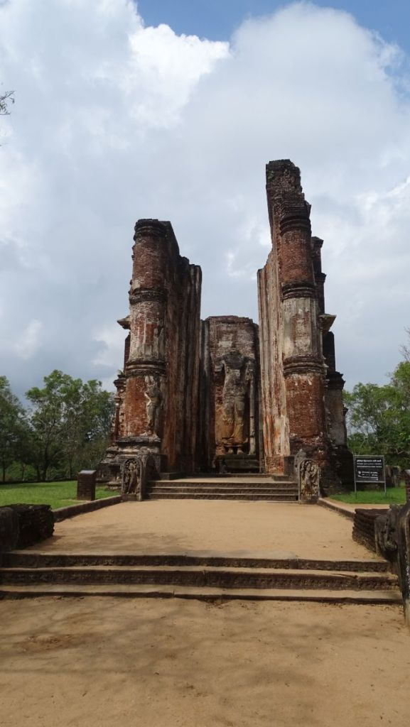 Massive columns, walls and a headless standing Buddha statue are the only remnants of Lankathilake temple at Polonnaruwa ancient city