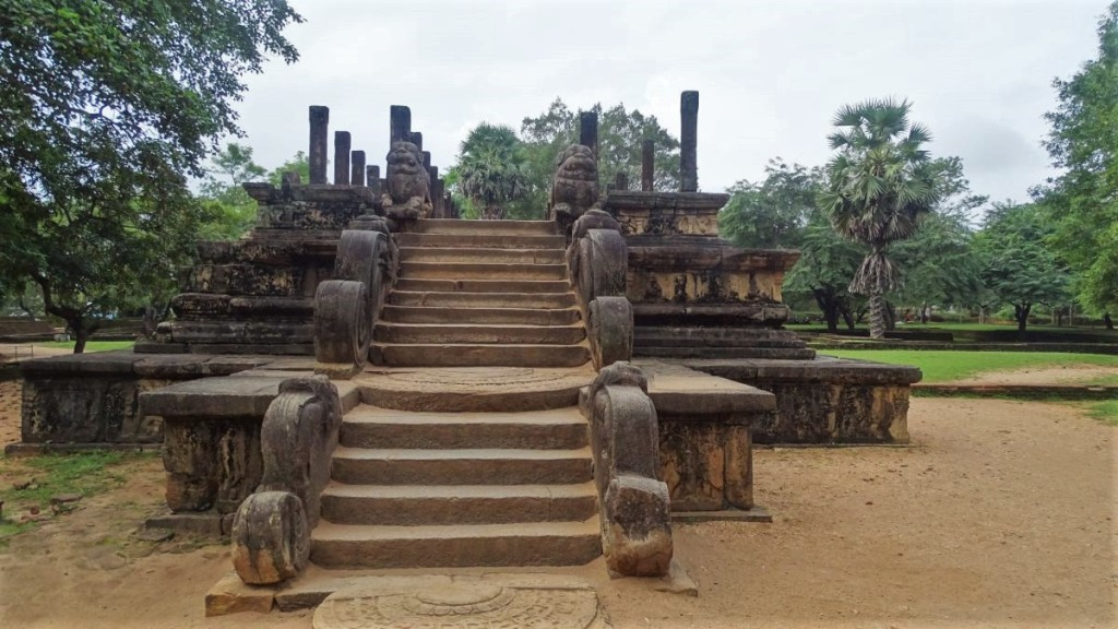 A half-circular moonstone, staircase with balustrades and lion sculptures leads to the royal audience hall at Polonnaruwa ancient city