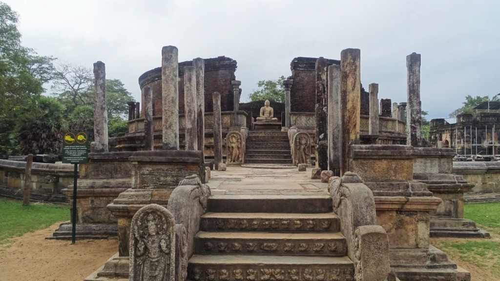 A round platform and circular walls give space to a seated Buddha statue at Polonnaruwa's Vatadage