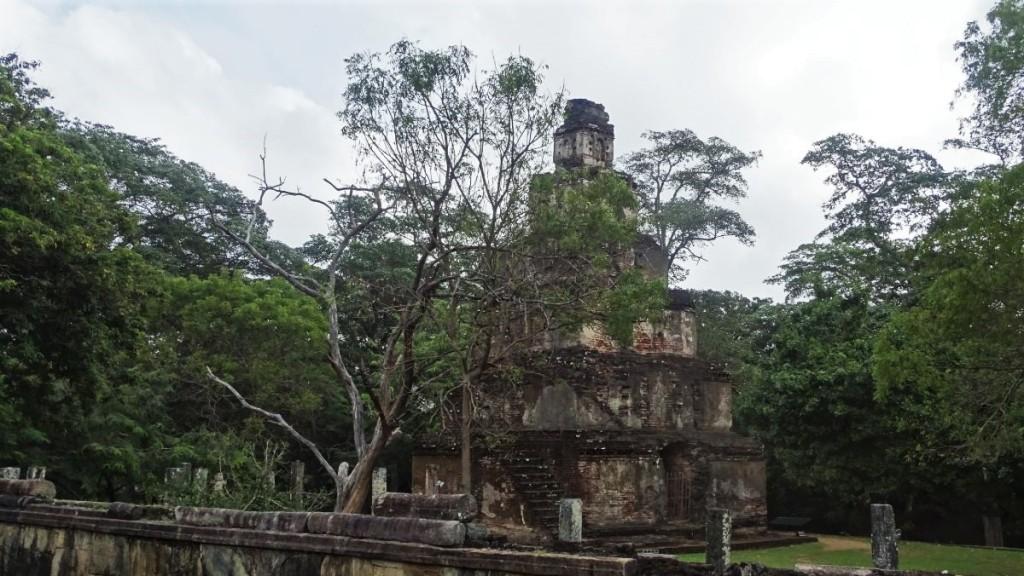 A brick, pyramid- shaped Sat Mahia prasadaya set among the trees at Polonnaruwa ancient city