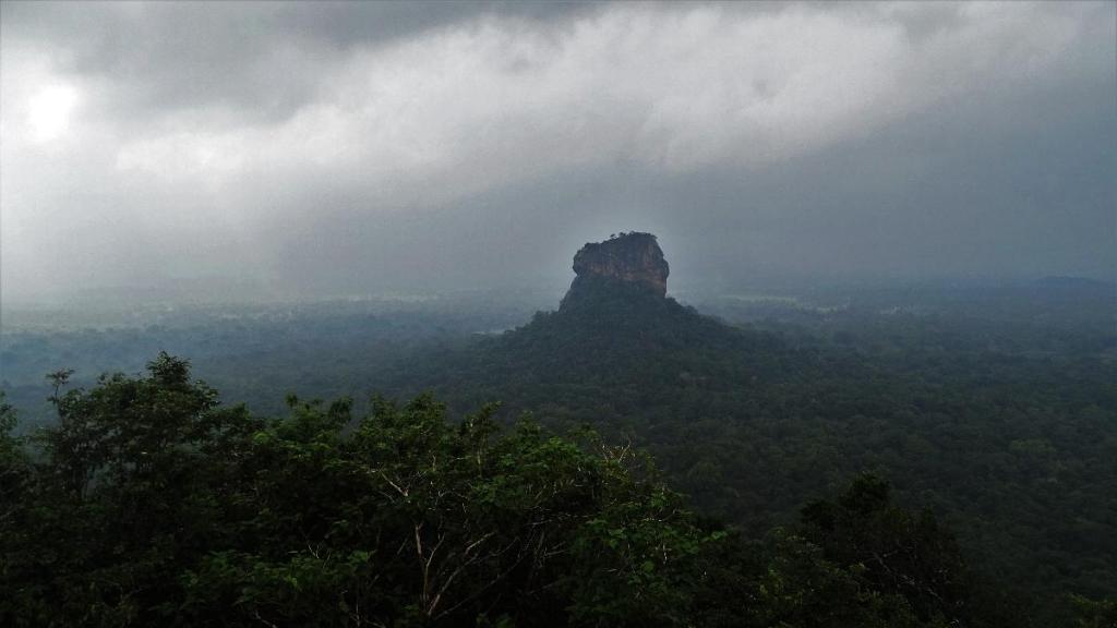A characteristic shape of bulbous Sigiriya rock rising 200 meters above the green Sri Lankan plains