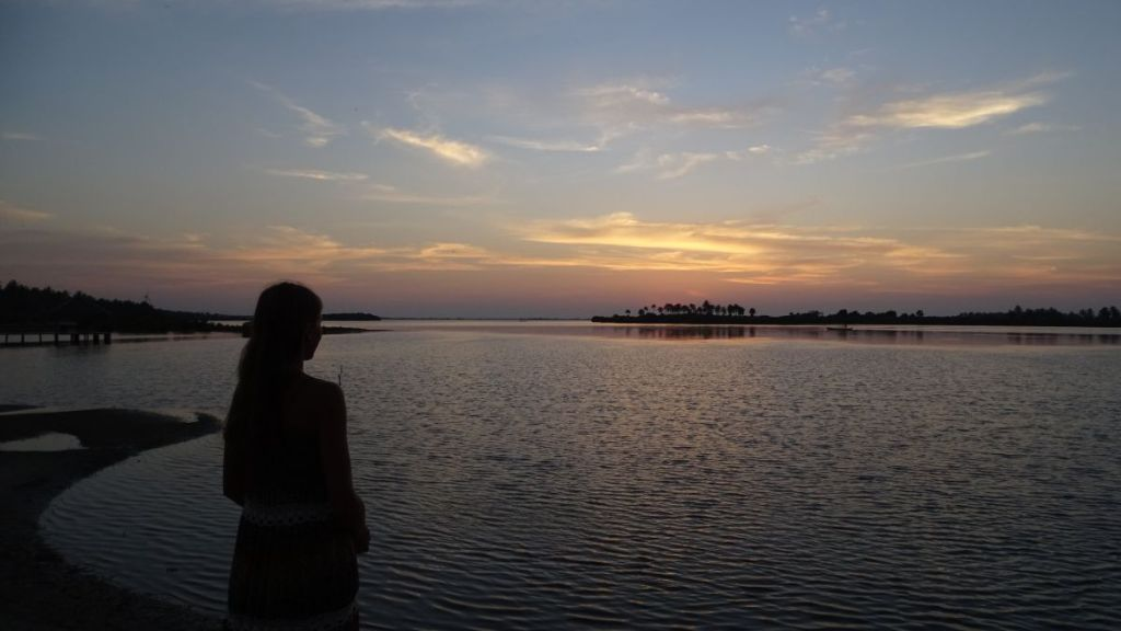 The author soaks in the view of the lagoon in Kalpitiya at sunset