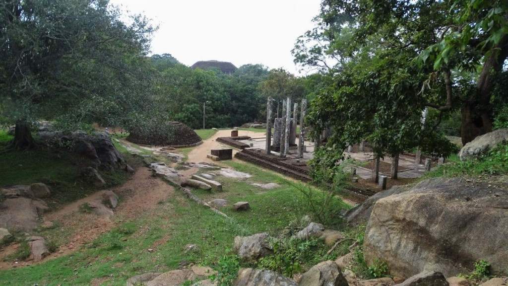 Rock platform, stone columns and two giangt granite slabs are the remains of a monastery at Mihintale hill