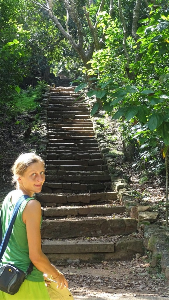 The author stands at teh bottom of long, stone stairs leading to Eth Vihara in Mihintale