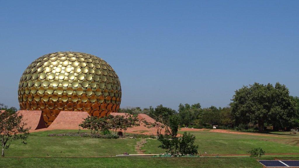 Solar panels power Matri Mandir a golden sphere serving as meditation space for Auroville community