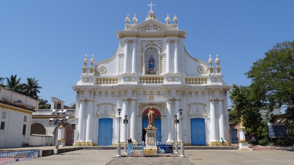 A white, baroque facade of the Immaculate Conception Cathedral in Puducherry