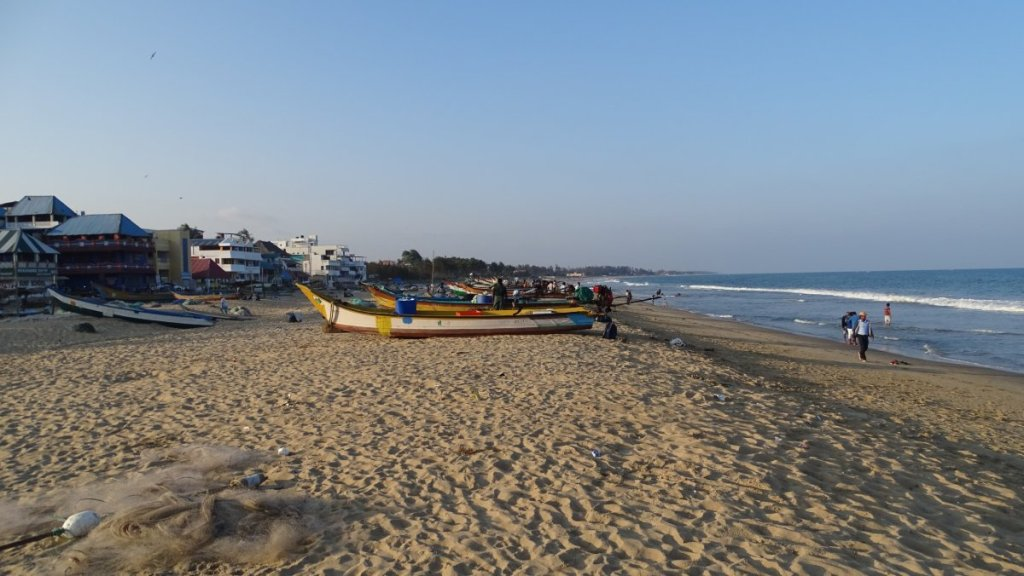 Sandy beach filled with fishing boats and nets in Mamallapuram