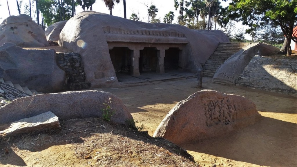 A 7th century small Siva temple cut in stone stands in a pine forest near Mamallapuram