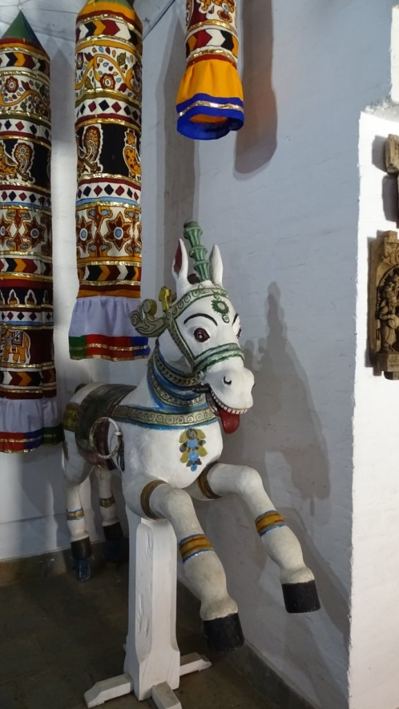 A wooden, fold sculpture of a white horse at the Dakshina Chitra ethnographic museum