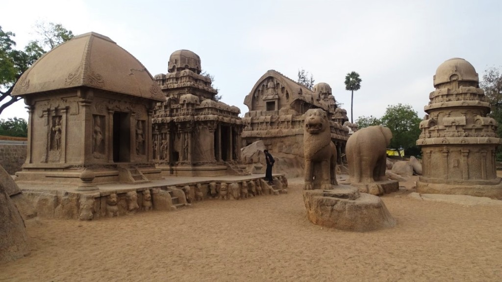 Five rathas: five small stone temples, each one with a large animal statue in front of it