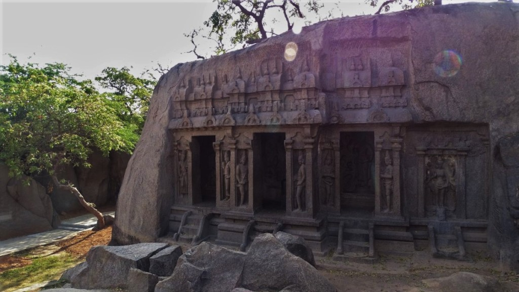 Richly carved front of one of the temples cut in the rock in Mamallapuram
