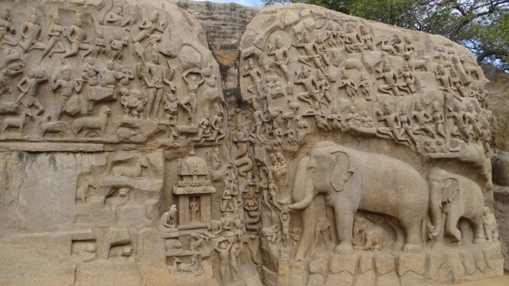Arjuna's Penance: two boulders entirely covered in reliefs including human-serpent forms, a yogi, elephants and other divine and animal figures